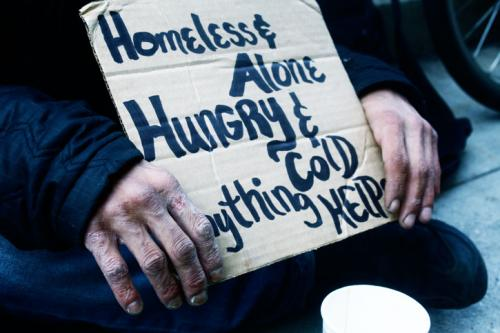 Johnny sits homeless alone hungry and cold begging for money led to the motivation for change change and help others succeed