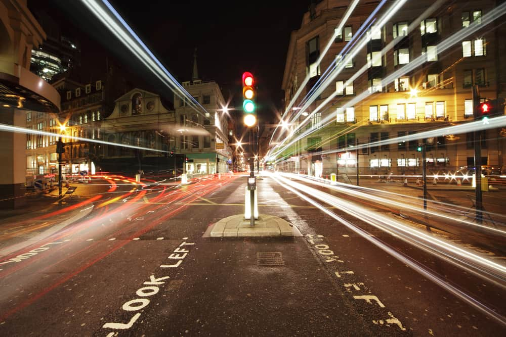 A traffic light in the middle of the street in London is Red it signifies the coping skill Stop Look Listen.